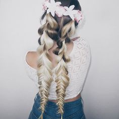 Thick to tight double fishtail braids! Loving this sweet look and she adds statement flowers to add a feminine and festive look!