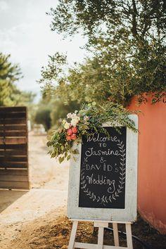wedding-sign-and-floral-decoration-in-shades of pink-tangerine-red Wedding Pics, Diy Wedding, Wedding Reception, Dream Wedding, Wedding Day, Wedding Things, Cyprus Wedding, Chalkboard Wedding, Unique Weddings
