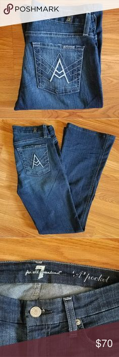7FAM A pocket flares GREAT CONDITION! These jeans are a gorgeous dark wash with slight fade design on front. Flare cut on the leg, perfect for boots or with heels or pointy flats. Materials tag is cut out as shown in last picture. 7 For All Mankind Jeans Flare & Wide Leg
