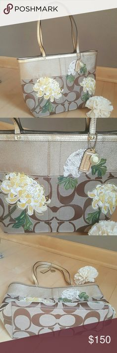 EUC Coach Signature Khakhi/Gold Stripe Floral Tote Preloved & in great condition. Like new. Only used couple of times. No rips,stains or damage. There is a slight spot & few scratches at gold trim at the back but not noticeable at all. Interior & exterior is crisp clean. Beautiful Signature Jacquard tote. Leather floral applique, metallic leather handles & trim. Interior lined with satin. Dog leash clip closure. Interior has one full size zipper pocket and 2 good size slide pockets. Ring to…