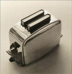 a toaster with books? Surrealism Photography, Conceptual Photography, Abstract Photography, Still Life Photography, Book Photography, Creative Photography, White Photography, Poema Visual, Foto Art