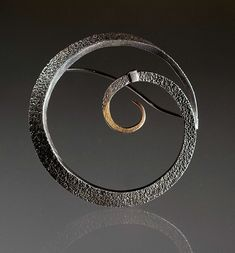 Fused Fibonacci by Seattle jeweler Andy Cooperman in a variety of unique materials.