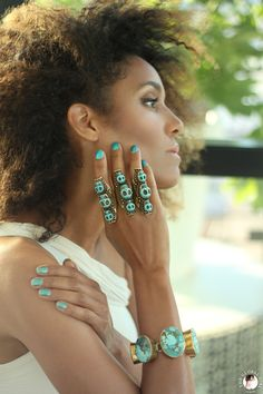 The Global Girl Fashion Editorials: Ndoema sports multiple turquoise and brass skull rings with a matching oversized bracelet.