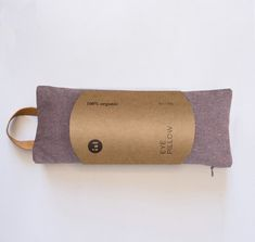 This 100% organic, scented, luxurious eye pillow adds light pressure to your eyes and aromatherapy to your practice. Great for relaxing, laying meditation, yoga nidra, aiding in sleep and relief of headaches. Scented eye pillow is filled with organic lavender and flax seeds. Try it heated in the microwave or cooled in the freezer. Details: 12oz, 100% organic, heavy weight recycled cotton and hemp fabric 100% organic cotton inner liner filled with organic flax and lavender (vegan) paper… Relaxation Gifts, Hemp Fabric, Meditation Cushion, Just Relax, Leather Handle, Aromatherapy, Ash, Organic Cotton, Wellness Studio