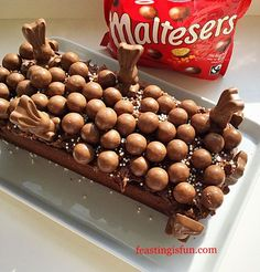 Maltesers Malted Chocolate Loaf Cake a moist, malted chocolate cake, topped with thick Chocolate Spread and decorated with Maltesers and bunnies for Easter.