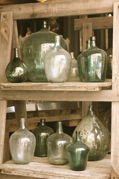 The beauty of glass bottles - thinking of adding some above kitchen cabinets. Different shades and sizes.