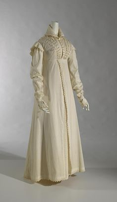 1820 ca.   Pelisse, English.  Cream, Empire-waisted, pelisse dress with ruffled sleeves, high collar, decorated bodice, and vertical decoration down front opening.                                 ngv.vic.gov.au                                        suzilove.com