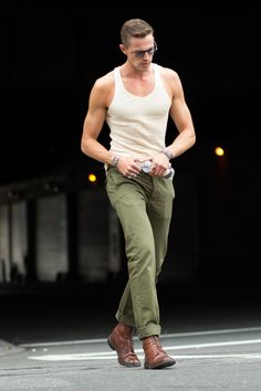 The model Tom Barker in olive green pants and a vintage 1940s tank after the Nautica presentation. (Photo: Marcy Swingle for The New York Times)
