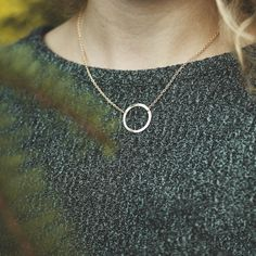 Unity Necklace - The popular Unity Necklace comes with a simple textured circle #pendant and 18-inch #chain, it serves as a reminder for us to come together and fight against modern-day slavery. #Handcrafted in India by a survivor of modern-day slavery and available in #gold or #silver by #purposejewelry part of #isanctuary. See more #ethical  #jewelry in our latest blog feature at www.styleandtrashion.com.