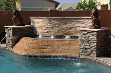 Stacked #stone #WaterFeature with #fountains and #spillway #spa #pool http://calpool.com