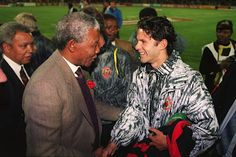 As part of those travels, Ryan Giggs (pictured wearing a questionable shellsuit) was to meet Nelson Mandela on Manchester United's tour of South Africa in June 1993 Manchester United Tour, Premier League, Football, Nelson Mandela, Man United, Sport, Cool Pictures, Champion, Kicks
