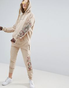 Buy it now. Criminal Damage Fire Joggers - Cream. Sweatpants by Criminal Damage, Soft-touch sweat, Drawstring waistband, Side and back pockets, Fitted cuffs, Fire design to leg, Regular fit - true to size, Machine wash, 100% Cotton, Our model wears a UK S/EU S/US S and is 174cm/5'8.5 tall. ABOUT CRIMINAL DAMAGE East London label Criminal Damage put their unique stamp on streetwear and give it a trend-led edge. Slogan print t-shirts and sweats span the dark and macabre to the bright and bold…