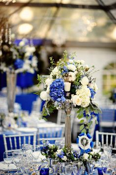 tall vases, cascading flowers, candles, show ribbons ... perfect