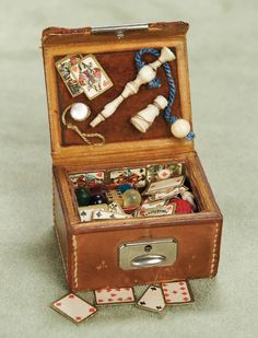 Theriault's Antique Doll Auctions, ca.1890 German valise with assortment of miniature toys.
