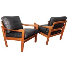 Illum Wikkelsø, a Pair of Teak and Leather Danish Lounge Chairs | From a unique collection of antique and modern lounge chairs at https://www.1stdibs.com/furniture/seating/lounge-chairs/