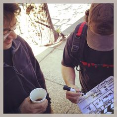 Very first scene - with crew - on location. Our sound genius, Douglas Horvat, fills out clapboard with Director of Photography, Daniel Traub, advising.