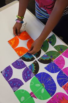 Radial design then cut into 4ths and glue to white paper. Cool! (Don Masse lesson)  First grade/ Kindergarten