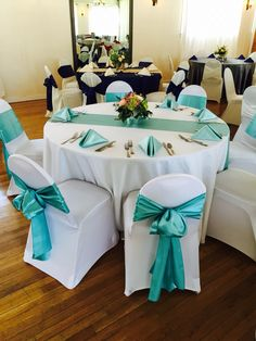 White and turquoise wedding linens. #fcc #weddings #reception #weddinglinens #summerwedding