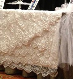Re-purpose an wedding dress into a table overlay  I wanted to donate my dress, husband never pitches a fit but put his foot down on this one in case we had a girl (whom I would never make wear my gown 20+ years later), we had a son.  I want that dress out of my closet space.