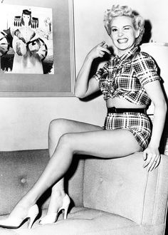 Betty Grable 1940s pin up girl funny photo print ad plaid shorts crop top heels shoes hair cheese cake print ad War Era WWII