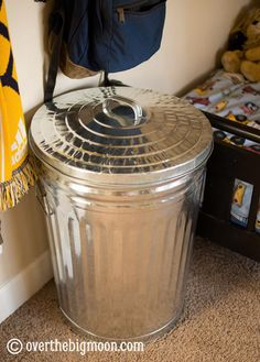 Great idea for a clothes hamper in a boy's room.  I would probably spray paint it to make it match the colors though.
