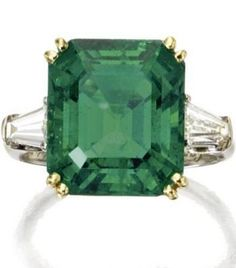 SS- Emerald is too big for me, but love the baguette diamonds on the side. Cartier Colombian emerald and diamond ring, Sotheby's.