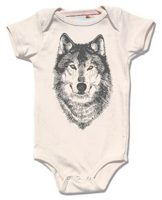 Our WOLF design is perfect for any little boy or girl this spring! Printed with a water-based dark grey ink on certified organic cotton and the wolfs eyes are gold foil.... plus, hand printed + sweatshop free! Let your little one howl in style!  * please note - metallic foil printing can be unpredictable, but always gorgeous! all sizes available:  infant bodysuit 3-6m, 6-12m, 12-18m  Thanks for visiting our etsy site! Please join our mailing list and find out about special sales & events…