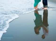 Maternity Photo on Beach - Reflection in Sand (I like the creative use of the reflection and where the couple reflection is located in the frame to the side).