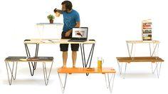 Eine gebogene Metalldrahtstruktur, ähnlich einer überdimensionalen Büroklammer, klemmt sich an jegliches Brett und verwandelt dieses ohne Schrauben und Werkzeug im Handumdrehen in einen einzigartigen Tisch.