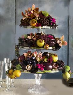 tiered design by Oscar Mora creates a beautiful still life with combinations of fruit and flowers.