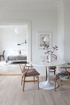 Scandinavian style in a dining area and bedroom with a neutral palette of white and wood tones - Neutral Home Ideas & Decor