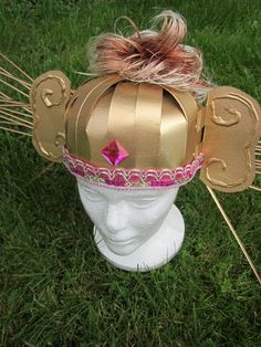 Monkey helmet... made from milk jug & spray paint? secured with tied headband with grip-hold elastic and bobby pins...