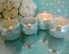 Dip glass in blue paint & glitter. Finish with ribbon and candle