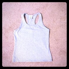 Old Navy racer back tank Old navy racer back tank top. Built in bra top.  No rips, stains, or tears. Great condition! ❌Trades ❌PayPal Old Navy Tops Tank Tops
