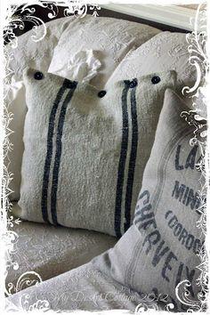Simple design grain sack fabric pillows. Cute button detail closure @ My Desert Cottage.
