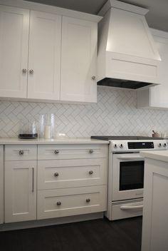white kitchen, herringbone subway tiles backsplash  -decorpad.com