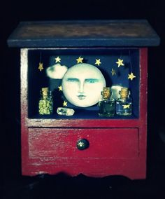 Moon Shrine. Love the repurposed night stand it looks like. Removing one drawer for display and supplies could be kept in other