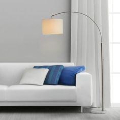 The Arc Floor Lamp by O&O by Olivia & Oliver adds a sleek, modern look to any room. Perfect over a sofa or chair, this wide sweeping arc lamp has an elegant marble base and a white linen fabric shade, allowing you to direct the light wherever you need it. Arc Lamp, Arc Floor Lamps, Steel Bed, White Lamp Shade, Fabric Lampshade, Fabric Shades, Incandescent Bulbs, Drum Shade, Contemporary