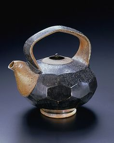Teapot with Faceted Body © Mark Shapiro  (b. 1955) Worthington, MA Teapot with faceted body, 2002 Thrown and altered stoneware with black glaze