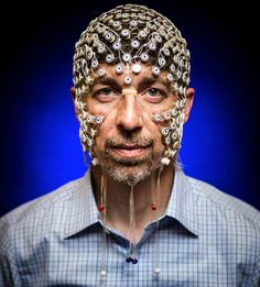 Electrical and computer engineering Professor Barry Van Veen wears an electrode net used to monitor brain activity via EEG signals. His research could help untangle what happens in the brain during sleep and dreaming. Photo by: Nick Berard