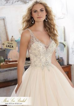 Style LNZA Madison Wedding Dress  Romantic Bridal Ballgown Features Crystal Beaded Embroidery on Net with a Billowy, Flounced Organza Skirt. New 2017 Collection. Open V-Illusion Back Accented with Covered Buttons. Colors Available: White/Silver, Ivory/Silver, Champagne/Silver. Shown in Champagne/Silver.