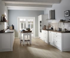The crisp, bright white of this Shaker style door can make even the most compact of kitchens feel more spacious. This is our Fairford White kitchen. Design your dream kitchen at Howdens. Big Kitchen, Home Decor Kitchen, Kitchen Interior, Vintage Kitchen, Kitchen Ideas, Kitchen Board, Kitchen Design, Howdens Kitchens, Kitchen Diner Extension