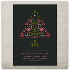 An elegant holiday wedding invitation with poinsettias, holly, flowers, starlight mints, pine cones and mistletoe. For minted.com by Carol Fazio
