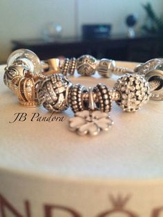 Pandora bracelet in white and gold