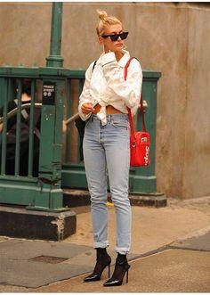 STYLECASTER | Hailey Baldwin Best Street Style Guide | high waisted denim, black heels, and pajama shirt