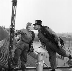 Mr Antoine Behiels (aged 63) of Woluwe-St-Pierre, Brussels, and his wife Marie walk kissing on a roof top as they sweep chimneys. 'She is a fantastic woman', says Antoine, 'she knows how to keep a man happy, and she has what it takes'.