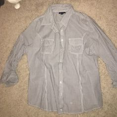 NEW Tommy Hilfiger long sleeve button up collar Long sleeve button up collared shirt. 2 pockets in front. Perfect condition. Never been worn! Tommy Hilfiger Tops Button Down Shirts