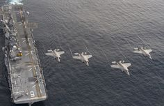 PACIFIC OCEAN (Nov. 19, 2016) Four F-35B Lightning II aircraft perform a flyover above the amphibious assault ship USS America (LHA 6) during the Lightning Carrier Proof of Concept Demonstration. The F-35B will eventually replace three Marine Corps aircraft; the AV-8B Harrier, F/A-18 Hornet and the EA-6B Prowler. (U.S. Navy photo by Andy Wolfe/Released)