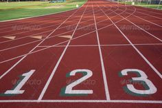 starting line of a running ltrack (curve, grass, green, lane, line, one, order, red, Running Track, sport, stadium, start, surface, synthetic, texture, three, Track And Field, training, turning, two, winning)