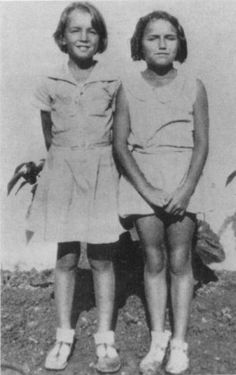 Norma Jeane (left) with a friend at the orphanage.